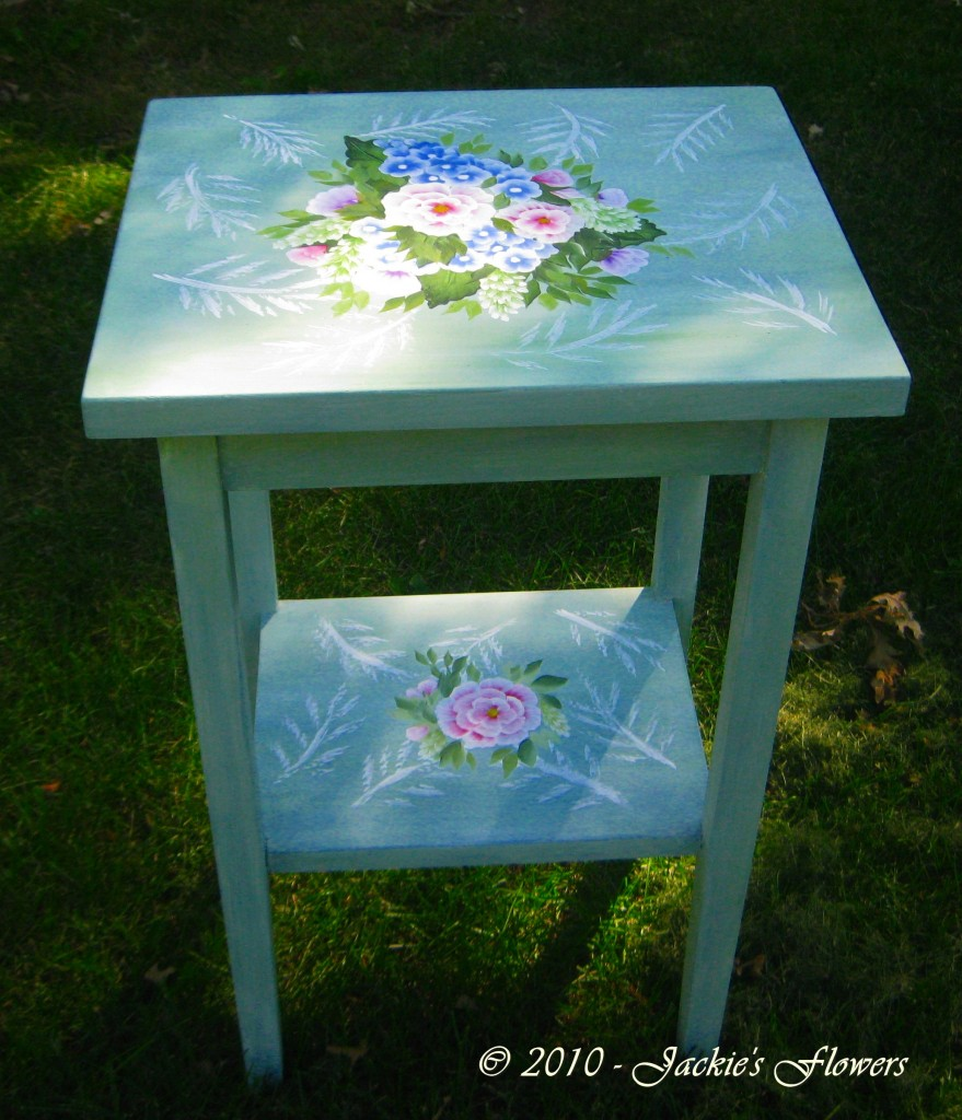 This little table got a fresh coat of vintage green paint and some flowers to brighten it up.