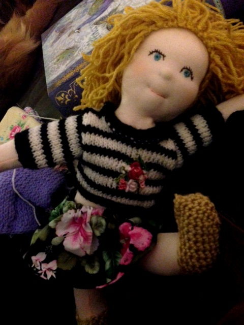 Doll with knit sweater and flower skirt